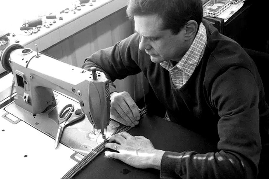 Master craftsman Simon Lucas working on a luxury table cloth