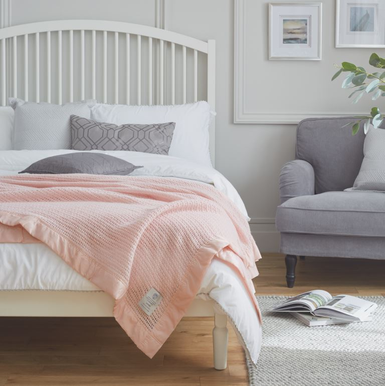John Atkinson Atkincel Powder Pink Blanket on a bed