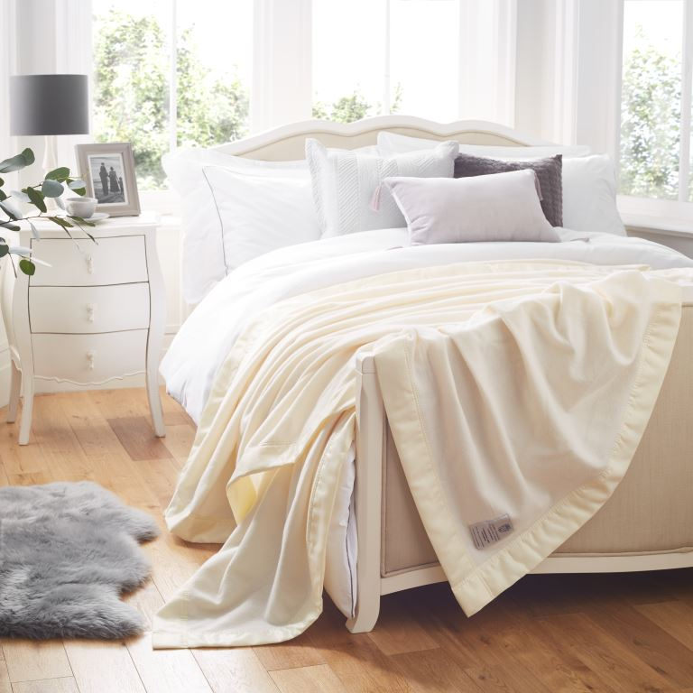 White John Atkinsion Luxury Lambswool Cashmere Blanket On a Bed