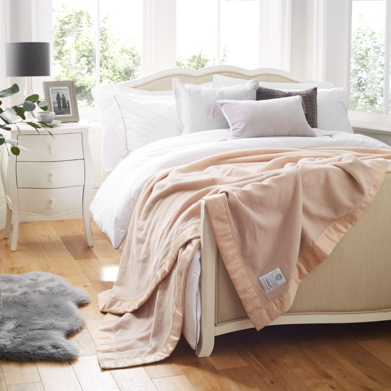 Champagne John Atkinsion Luxury Lambswool Cashmere Blanket On a Bed