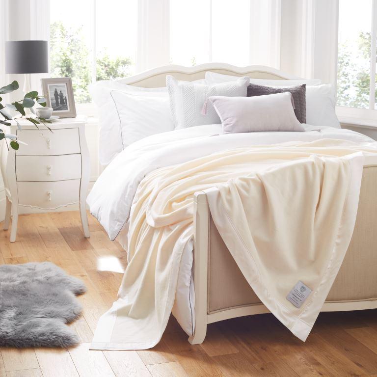 John Atkinson Cashmere De Lux Blanket White Silk on bed