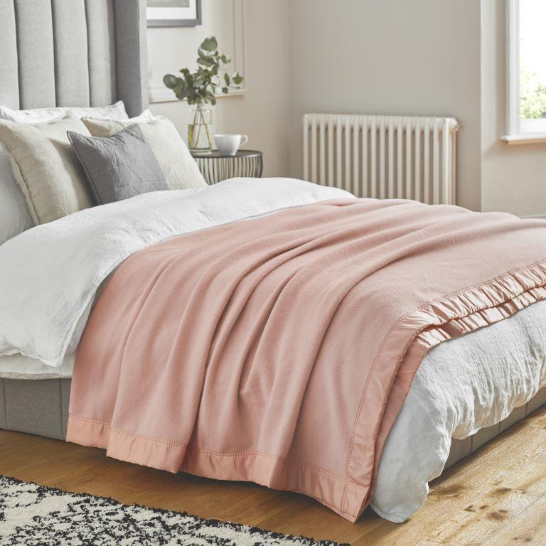 John Atkinson Duchess Blanket Powder Pink on Bed