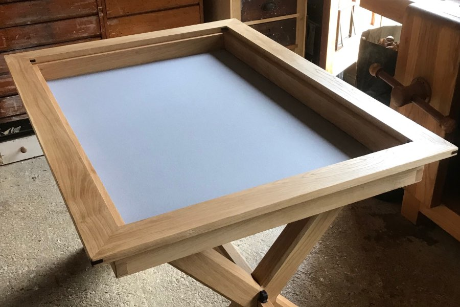 oak dining and gaming table by nick clouting